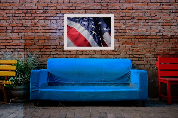 American flag hanging above couch